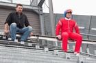 Hugh Jackman and Taron Egerton get into role as coach and ski-jumper.