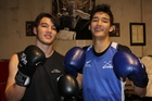 Up-and-coming boxers Floyd Chadwick, 16, of Peria and Kyle Chen, 15, of Haruru Falls are the winners of a scholarship set up in memory of firefighter, pilot and athlete Robin Thorin. Photo / Peter de Graaf