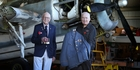 John Garland (left) and the medals he won serving with the RNZAF in the Pacific, with Classic Flyers chairman David Love holding his donated dress uniform. Photo / John Borren