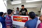 Anil Kumar serves a customer from his Diversity The Taste on Wheels cart on Maunu Rd. Photo / John Stone
