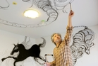 Ryosuke Yasumoto paints a ceiling at the Park Hotel, Tokyo.