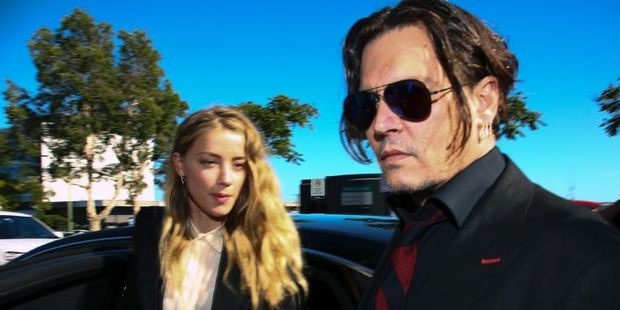 Loading US actor Johnny Depp and his wife Amber Heard arrive at a court in the Gold Coast. Photo / AFP