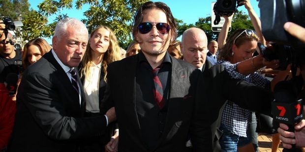 Depp and Heard arrived at an Australian court over Heard's alleged illegal importation of their two dogs. Photo / AFP
