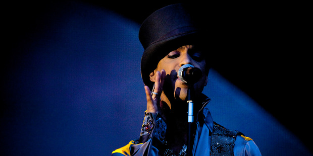 Loading Purple Rain is sitting at number one on the iTunes songs chart in New Zealand, with Raspberry Beret at number four and When Doves Cry at number seven. Photo / AP Photo (Polfoto/Jakob Joergensen)