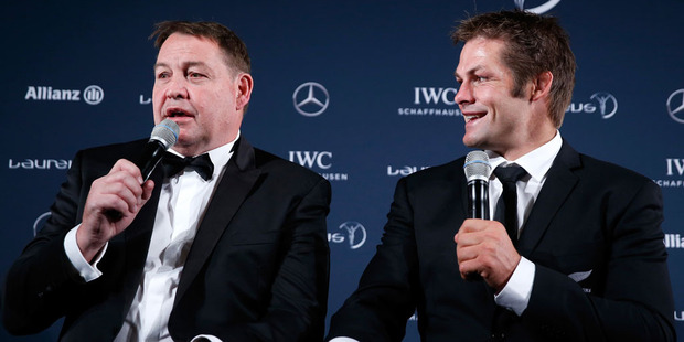 Loading Steve Hansen, coach of the All Blacks with All Blacks Captain Richie McCaw on behalf of the All Blacks. Photo / Getty Images.