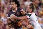 Adam Blair of the Broncos attempts to break away from the defence during the round six NRL match. Photo / Getty Images.