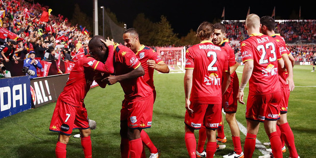 Adelaide players celebrate at the end of the A-League Semi Final match between Adelaide United and Melbourne City. Photo / Getty Images.