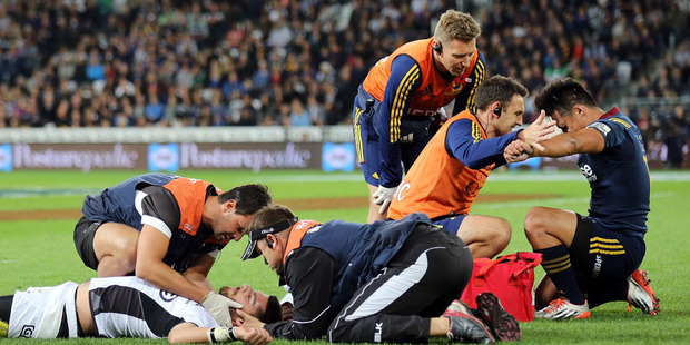 Willie Le Roux of the Sharks and Jason Emery of the Highlanders are attended too during the round nine Super Rugby match. Photo / Getty Images.