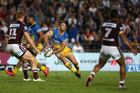 Kieran Foran (centre) of the Eels takes on former team, the Manly Sea Eagles at Brookvale Oval. Photo / Getty