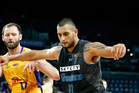 Duane Bailey of the Breakers holds back Anthony Petrie of Adelaide. Photo / Getty Images