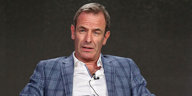 The vicar's Filipino wife of 16 years left him for Robson Green. Photo / Getty Images