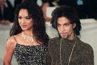 """LONDON, UNITED KINGDOM - JUNE 10: Prince poses for photographers with his wife Mayte as they arrives at the De Beer and Versace """"Diamonds are forever"""" charity fashion event 09 June 1999. A"""