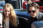 Johnny Depp and his wife Amber Heard arriving at court in Gold Coast, Australia this morning. Photo / Getty Images