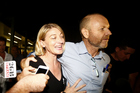 Australian television presenter Tara Brown and producer Stephen Rice arrive at Sydney International Airport last night. Photo / Getty Images