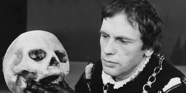 French actor Jean-Louis Trintignant holding the skull of Yorik during a scene from the Shakespeare play Hamlet. Photo / Getty Images