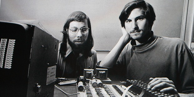 Apple Inc. CEO Steve Jobs speaks in 2010 in front of a file photograph of him and fellow co-founder Steve Wozniack. Photo / Getty