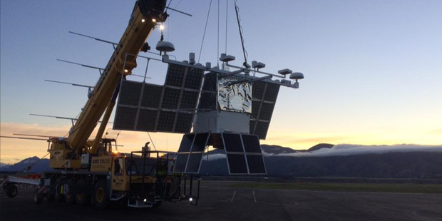 A crane takes Nasa's weather balloon back to the hangar at Wanaka Aerodrome earlier this month after the launch was postponed due to inclement weather. Photo/ Facebook/Nasa