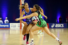 Mystics Kayla Cullen (L) and Fevers Andrea Gilmore in action during the Mystics v Fever ANZ Champs netball match played at Trusts Arena in Auckland. Photo / Michael Bradley.