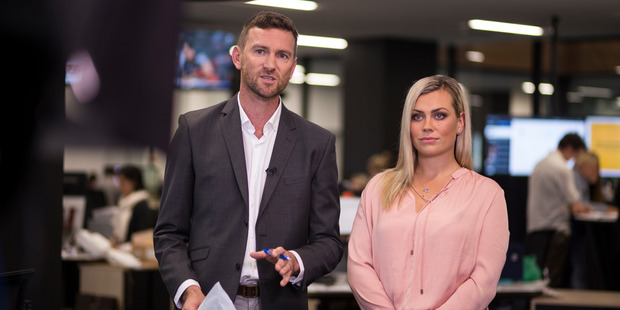 Tristram Clayton and Laura McGoldrick broadcast from the bridge at the NZME newsroom. Photo / Dean Purcell