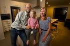 Former Aucklanders James Rea (left) and Ivana Rea, with daughter Alexis Rea, 2, in their new house in Papamoa. Photo / Alan Gibson