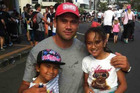 Former Blues rugby player Kurtis Haiu and his daughters, Sienna, 6, (left), and Aaliyah, 8 during the Round The Bays run. Photo / Supplied.