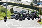 Police oversee the convoy of Outlaw Motorcycle Gang members.