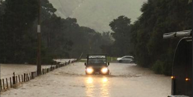 Flooding on the Coromandel to Colville Road on Sunday. Photo / Supplied via www.facebook.com/waikatoroa