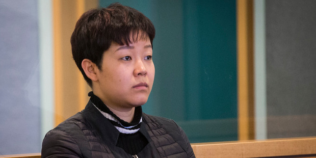 Yixin Gan in the High Court yesterday. The Crown alleges she used her food-shipping business as a front for importing the precursor drugs. Photo / Jason Oxenham
