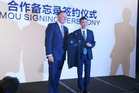 PM John Key hands an All Blacks jersey to Alibaba founder Jack Ma during a trade meeting in Beijing this week. Photo / via Twitter/John Key