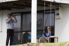 Police take photos of the swing and the chain, at the house at Mangawhai Heads. Photo / Brett Phibbs