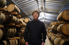 Ichiro Akuto, president of Venture Whiskey Ltd., poses for a photograph at the company's Chichibu distillery. Photo / Bloomberg