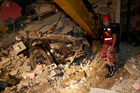 A rescue worker searches in the rubble of a destroyed house in Pedernales, Ecuador. Photo / AP