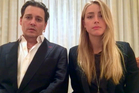In this image made from video released by the Australian Government Department of Agriculture and Water Resources of actor Johnny Depp and his wife, Amber Heard.