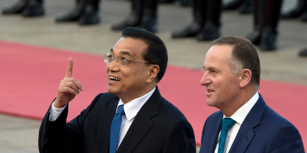 Prime Minister John Key, right, and Chinese Premier Li Keqiang, left, chat during a welcome ceremony outside the Great Hall of the People in Beijing, China. Photo / AP