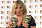 Victoria Wood holds her two Bafta awards, one for Best Actress and one for Best Single Drama, in 2007. Photo / AP