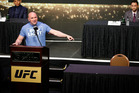 UFC president Dana White speaks beside an empty chair where Conor McGregor was supposed to sit during a news conference for UFC 200. (AP Photo/John Locher)