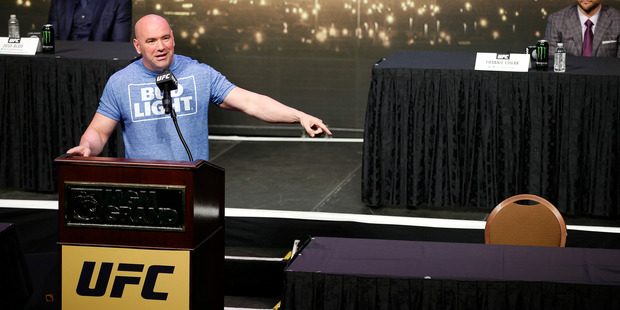 Loading UFC president Dana White speaks beside an empty chair where Conor McGregor was supposed to sit during a news conference for UFC 200. (AP Photo/John Locher)
