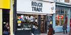 Tourists take photos outside the Rough Trade record shop in London. Photo / AP