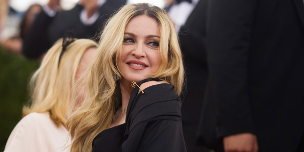 """Madonna hit headlines last month when she was ordered to remove signs in front of her townhouse which read, """"Tenant parking only."""" Photo / AP"""
