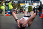 Ben Ruthe from Tauranga catches his breath at the finish of the Rotorua Marathon.