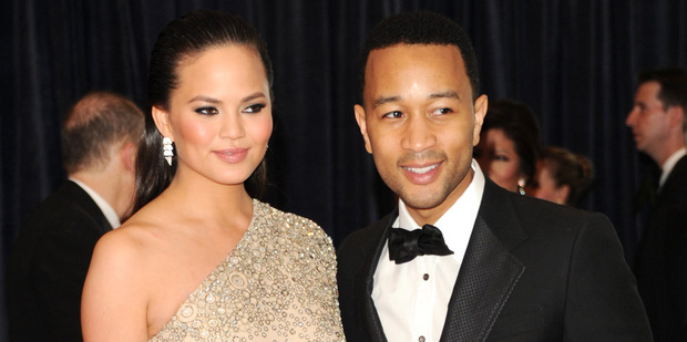 Christine Teigen and John Legend announced their tiny daughter's birth last Thursday on social media. Photo / AP
