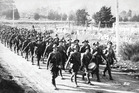Soldiers on the march before embarking in ships berthed in Wellington Harbour, bound for World War 1.