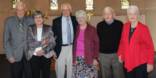 Three Dannevirke couples celebrate their 60th wedding anniversaries at St John's Anglican Church in Dannevirke yesterday. John Burn (left), Jill Burn, Jim and Judy Kernaghan and Robin and Margaret Larsen. Photo / Christine McKay