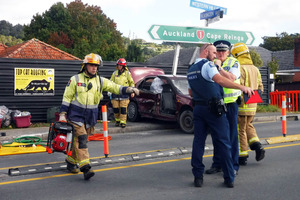 Emergency services on Western Hills Dr, Whangarei, following a pursuit. PHOTO/ Kristin Edge
