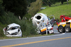 The aftermath of a car and concrete truck collision on Lookout Hill, near Whangarei. PHOTO/Michael Cunningham