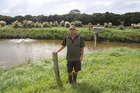 Stuart Abercrombie by one of  his two effluent storage ponds that provide up to eight months of liquid capacity. Photo / DairyNZ
