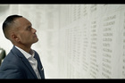 CONNECTION: Pita Pirihi reads the names of fallen soldiers in the World War I Sanctuary at Auckland War Memorial Museum. He didn't know he had a great uncle who served in World War I until he became part of a Maori Television documentary called The Blood We Share.PHOTOS/SUPPLIED