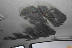 SCORCHED: The falling power lines set fire to the lining inside Mr Sisley's car. PHOTO/DARREN MARKIN