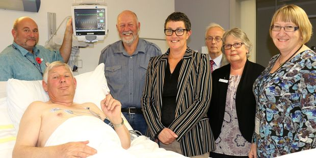 HOOKED: Former Masterton mayor Garry Daniell, who is chairman of the Wairarapa Community Health Trust, hooked up to a cardiac monitoring system worth over $300,000 donated to Wairarapa Hospital by the trust, with charge nurse manager of Acute Services Stephen Downey-Fribbens (left), trustee Tom Ward, trustee Leanne Southey, trustee Dr Alan Shirley, charge nurse manager of MedicalSurgical Ward and trustee Susan Reeves, and interim hospital manager Jill Stringer. PHOTO/HAYLEY GASTMEIER