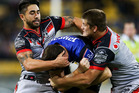 Josh Morris of the Bulldogs is tackled by Shaun Johnson and Blake Ayshford of the Warriors. Photo / Getty Images.